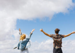 excited-free-couple-with-hands-up