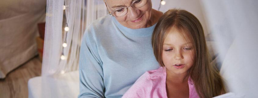 Grandmother teach granddaughter how spelling